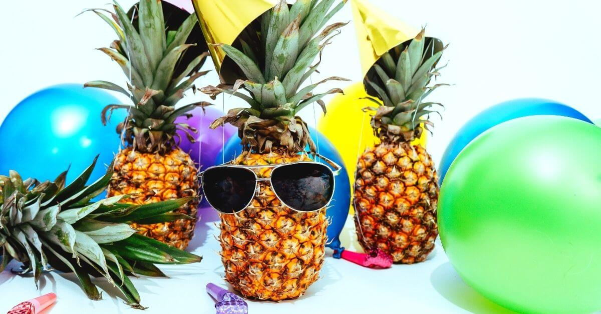pineapple with sunglasses and balloons