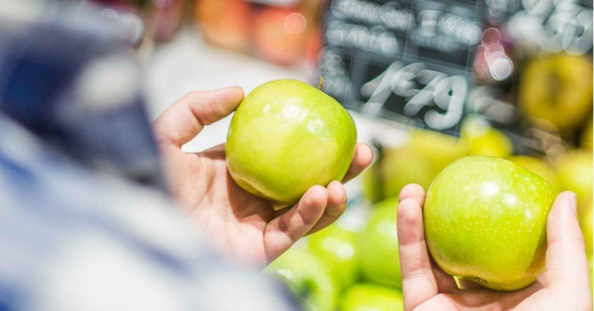 choosing between two green apples
