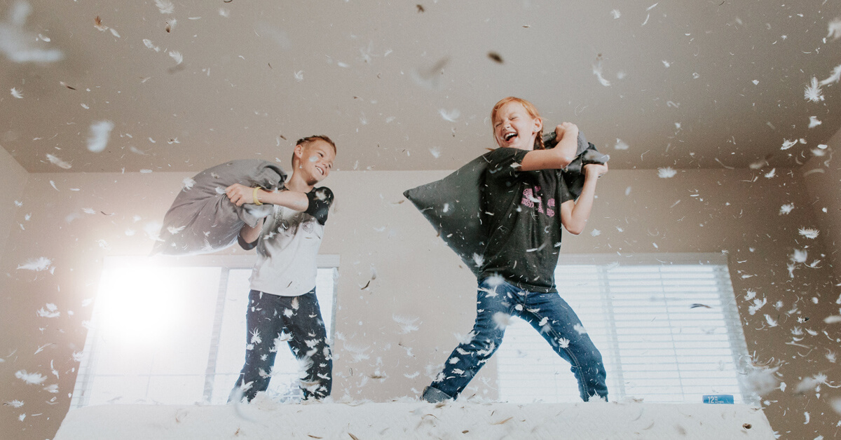 SEO v PPC - Two children pillow fight