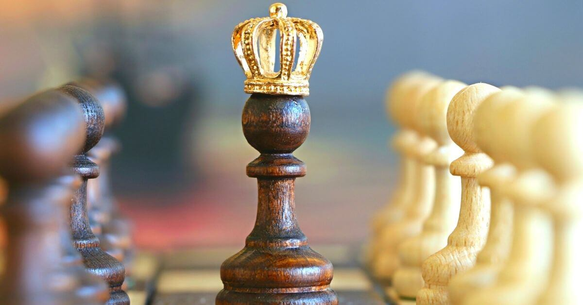 a chess pawn which a crown on top of it