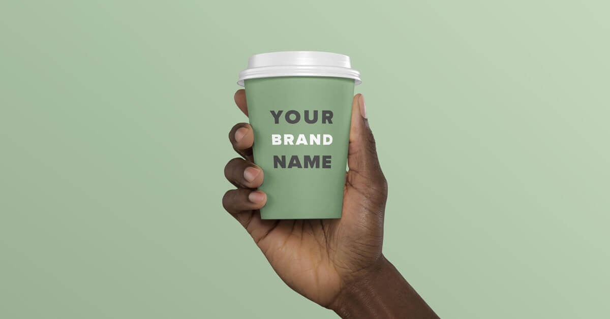 some one holding a green cup